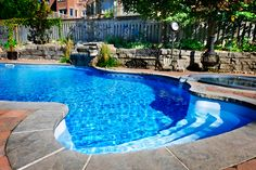Small Pools For Small Backyards | Swimming pool with waterfall | Apollo Pools