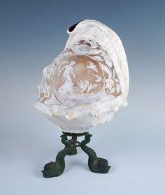 This is an exceptional antique lamp featuring a carved conch shell shade. Aphrodite's medallion is surrounded by a richly detailed group of twining vines and flowers in full bloom. A small landscape medallion depicting a smoking volcano rests at the top of the fabulously engraved decoration. | eBay!