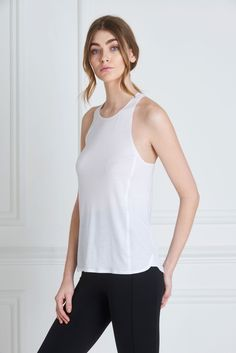 Maria Tank White - A faultless fit and soft, non-toxic jersey material make the Maria Tank a must have. The scooped racer back and high neckline front are impeccably assembled with bonded seams. A multipurpose piece, it can be worn from the markets to the Yoga mat, with many a tea date in-between.