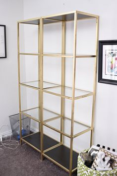 DIY tutorial: IKEA VITTSJO shelving unit hack using gold spray paint and the best marble contact paper. The end result looks amazing in the ...