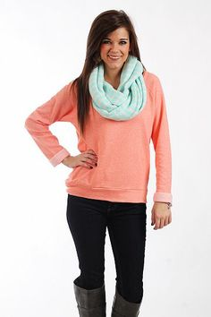"""The Molly Top, Coral $37.00  You'll be ready to ditch your favorite sweatshirt when you get your hands on this top! The soft piece has a v neck and cuffed sleeves and is a heathered coral color that will match so many things! Plus, it can be worn so many different ways!   Fits true to size. Miranda is wearing a small.   From shoulder to hem:  Small - 23""""  Medium - 24""""  Large - 25"""""""