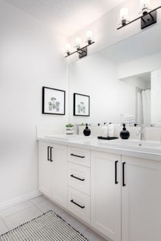 Great idea for an all white bathroom. Bathroom cabinets have a sharp black handle hardware. Collingwood Livingston Bathroom in Excel Homes All White Bathroom, Black White Bathrooms, White Bathroom Cabinets, Bathroom Hardware, Bathroom Renos, White Cabinets, Bathroom Interior, Small Bathroom, Light Grey Bathrooms