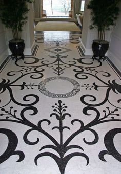This well lit entry way follows an old roman mosaic style that was updated in classic black and white colors. www.Vita-Nova.com
