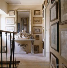 The walls of this corridor are lined from floor to ceiling with framed prints and engravings in this French home in the Loire valley - David Hare