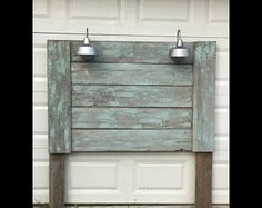 Barnwood headboard in duck egg wash with double galvanized lights. Rustic Home Decor. Farmhouse decor. Vintage. Beach decor. Queen headboard
