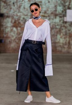 Eleanor Pendleton wearing a white Vetement shirt with long sleeves, a midi utility skirt and white sneakers