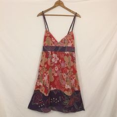 "ECOTE embroidered cotton empire tank dress New, unworn condition; tags attached. 100% cotton, fully lined. Smocked elastic at rear. Adjustable straps. 36.5"" length with straps at longest. Urban Outfitters Dresses Midi"
