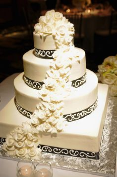 White chocolate wedding cake with white roses cascading down side