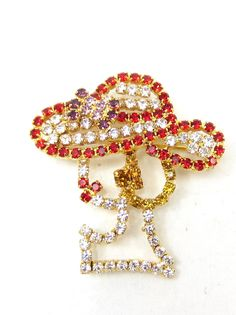 Brooches kid and vintage on pinterest for Red hat bling jewelry