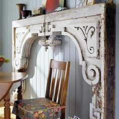 Two very large wood corbels paired to make a fireplace surround - salvage yard find!  Wonderful.