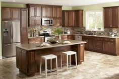 Image from http://www.plapoon.com/wp-content/uploads/2014/06/16-Kitchen-cabinets-home-depot-with-brown-theme-670x447.png.