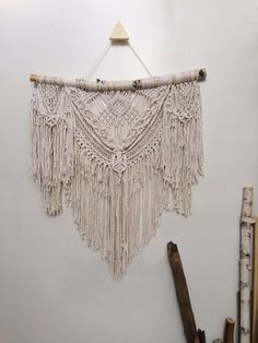This 4-foot wide boho macrame wall hanging is an impactful statement piece that will transform your space. Its extremely detailed and made up of