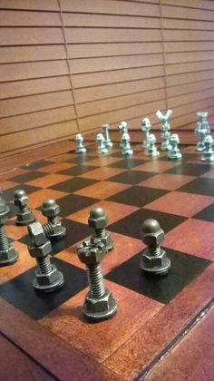 Steampunk metal chess set. Nuts and bolts handmade chess set. Super cool! I want it for myself!