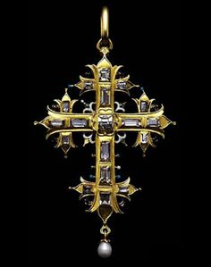 The front of the cross is set with table cut diamonds in plain gold rimmed settings, and where the arms and upright meet at the centre there are stylised enamelled lilies, echoing those at the four extremities. The back is enamelled with a pattern of flowers and leaves in colours on a white ground. Spain or Austria, c. 1620. Click for source and additional commentary by Diana Scarisbrick