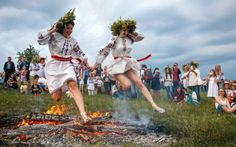 Ukrainians jump over a fire during the traditional Slavic celebrations of Ivana Kupala in Kiev, Ukraine