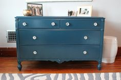 Re painted dresser and crystal knobs. Color used: Behr Restless Sea UL230-23