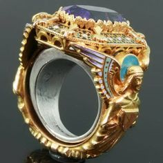 Gold Victorian Bishops ring with stunning enamel work and hidden ring with stalking wolf
