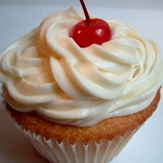 White Buttermilk Cupcakes with Pineapple Filling and Cream Cheese Frosting.