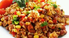 Quinoa, corn, beans, and cilantro are tossed in a spicy chile dressing creating a Mexican-inspired salad perfect for lunch or dinner. Mexican Quinoa Salad, Quinoa Salad Recipes, Quinoa Recipe, Mexican Salads, Quinoa Dishes, Quinoa Bowl, Vegan Dishes, Vegetable Dishes, Cooking Recipes