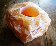 Orange Calcite Crystal Tealight Candle Holder...Orange Calcite is highly energizing and a powerful cleanser of energy. Simply having Orange Calcite in the room cleans negative vibrations from the environment. It gently works to :: +balance the emotions +alleviate emotional stress +remove fear +overcome depression +dissolve problems +heal the reproductive system +soothe symptoms of irritable bowel syndrome (IBS). It is a powerful addition to any space.