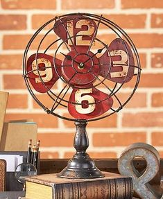 The Industrial Fan Table Clock makes a bold statement on your desk. It features 4 stationary blades inscribed with the numbers 9 and The blades are enclosed in a metal cage that makes it look like a real fan. Industrial Artwork, Industrial Wall Art, Industrial Fan, Vintage Industrial Furniture, Repurposed Furniture, Furniture Ideas, Industrial Dining, Industrial Office, Industrial Interiors