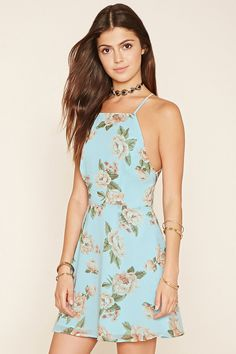 A woven A-line dress with an allover floral print, a square neckline, and cami straps that crisscross and tie at the back.