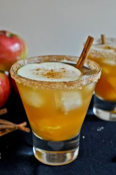 Apple Cider Margarita 1 ounce Grand Marnier 1 ounce gold tequila 5-6 ounces sweet apple cider orange segments and apple slices cinnamon + cane sugar + coarse sugar for glass rimming cinnamon sticks for garnish