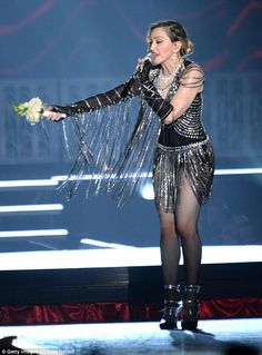 Army of fans: Madonna held a small bunch of flowers at one point during the show, presumably given to her by her legions of fans