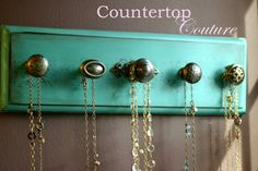 "A great way to display and organize your jewelry, aprons,scarves, leashes, necklaces ,etc.. Beautiful shabby chic style necklace rack to hang on a wall, closet,door, etc. Hand painted and distressed with 5 eclectic knobs. 1 of a kind.    rack measures 15"" x 4 1/2"" .. hanging hooks mounted on back    sorry...necklaces not included : ))"