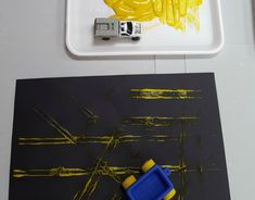 Transportation Activities - Learn how to make fun tracks with cars and paint! www.momonthemove35.com