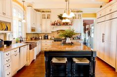 Traditional French Country Kitchen Design Ideas with Elegant White Kitchen Cabinets and Black Kitchen Island with Brown Marble Countertops