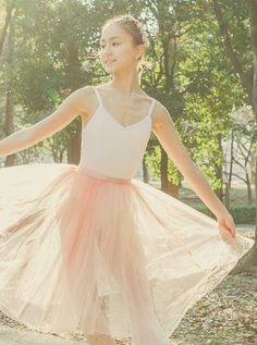 On Miko Fogarty: The ready-to-wear tulle skirt in white/rose coral (pictured: unlined. Actual skirt is fully lined.)