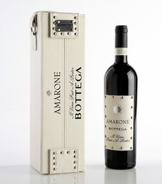 The renowned American designer Denise Focil has partnered with the award-winning  Italian wine maker Distilleria Bottega to create a luxury and stylish wine: Amarone Bottega, Il vino Prêt-á-porter.    The bottle features a white leather label and is nestled in a white leather case embellished with debossed black lettering: a collectible piece that reminds of a vintage suitcase. The case is enriched with metal studs (the latest, hottest fashion trend) and with a metal plaque with engraved the…