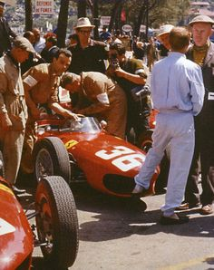 "Phil Hill, who took this photo and went on to win the 1961 Championship, recalled: ""Monaco with the 1.5-litre V6 `Sharknose' Ferrari, the car I drove to score my World Championship back in 1961. Here in the pits, one of our mechanics glares at my old friend Richie Ginther, who's resting his foot in the car's right nostril. Richie was always very quick around Monte-Carlo - he made his GP debut there in 1960, and in '61 he finished second, ahead of me."