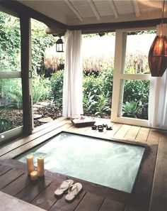 Covered backyard hot tub, I love this, especially the plants around outside.