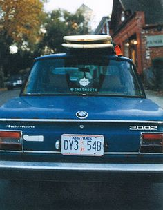 My First Car but with just one surf board for the ride to Malibu!  BMW 2002!!