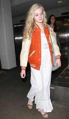 Adorable Elle Fanning wears an orange and cream coloured letterman.