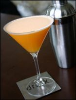 Orange Creamsicle Martini: 4 oz. diet orange soda, room temperature,    1.5 oz. orange-flavored vodka (like Smirnoff Twist of Orange), 1.5 oz. Torani Sugar Free Vanilla Syrup, 1 tbsp. Cool Whip