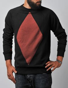 Sweater in black Print: big diamonds in red Please note that due to production-related causes every size of clothes will be one size larger. (e.g. When your Size is M, please order the Size S)