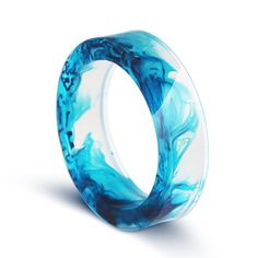 MAY YOUR JOY BE DEEP AS THE OCEAN, YOUR SORROW LIGHT AS THE FOAM  This ring is made of a clear and blue resin.