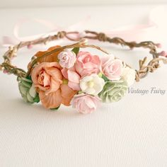 Welcome to Vintage Fairy This floral crown is divine, Perfect to match in with any outfit. Gorgeous peach, baby pink, and sage green flowers are clustered at the front.Sweet pink and gold berries twist around the sturdy wire base.Can be made to fit any age, please convo me a size during checkout Party, princess, peach, gold, baby pink, sage green, girls, flower crown, headpiece, floral wreath, halo, dress ups, special occasions, christening, baptism, birthday, gi...