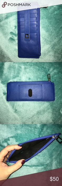 """Lodis Wallet Bright blue, leather, super skinny wallet. Used twice, great condition. Here is the product info from the website:  Organize all your credit, travel, store and gift cards in this classic LODIS case. Features RFID protection against skimming theft. Features:  8 credit card slots with strap to keep cards in place; exterior zip pocket, back ID slot with thumb glide. 7.5"""" x 3"""" Lodis Accessories Key & Card Holders"""