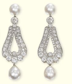 A PAIR OF BELLE EPOQUE DIAMOND AND NATURAL PEARL EAR PENDANTS   Each designed as a pavé-set diamond pear-shaped panel with natural pearl drop to the natural pearl surmount, circa 1900, 6.0 cm long, with French assay marks for platinum and 14k gold