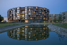 The Tietgen Dormitory is located in Ørestad north, where the open landscape of Amager common meets the stringent, orthogonal structures of the city plan, framed by the two channels of the area. The dormitory's round building shape equally addre Wooden Architecture, Architecture Plan, Residential Architecture, Interior Architecture, Drawing Architecture, Architecture Details, Patio Interior, Interior Exterior, Round Building