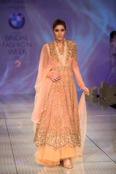 Tarun Tahiliani pink peach gold anarkali lehnga with tulle border. More here: http://www.indianweddingsite.com/bmw-india-bridal-fashion-week-ibfw-2014-tarun-tahiliani-show/