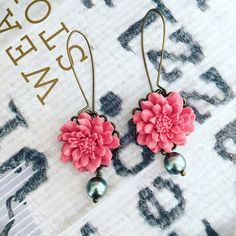 """NWOT Pink flower drop earrings These playful statement earrings are highly detailed, featuring pink resin flowers with pearls. The flowers are set in brass filigrees and hung from antique brass long kidney ear wires. Length approximately 2.4"""". Brand new never worn. All my items are buy one get one 50% off + free goodies listed in my closet. Happy holidays. Boutique Jewelry Earrings"""