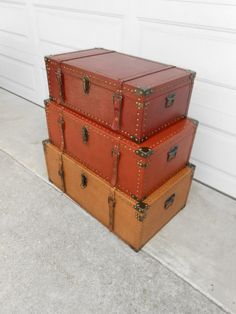 """Storage Wood And Leather Trunks. 3 Colors. 1 Large Trunk Dimensions: 32""""W, 13""""H, 19""""D. $95.00. Medium: 29""""W, 11""""H, 17""""D. $65.00. Small: 25""""W..."""