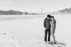 Baker Beach Engagement Couples Shoot- Cuddling in the Ocean under the Golden Gate Bridge