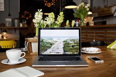 Macbook pro in the bistro photo by show it better on Creative Market