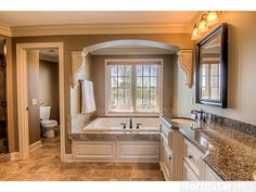 Tastefully renovated in soothing natural hues and fine finishes, this #master bathroom is impressive with its furniture grade built-in cabinetry, accent lighting, and stone finishes.